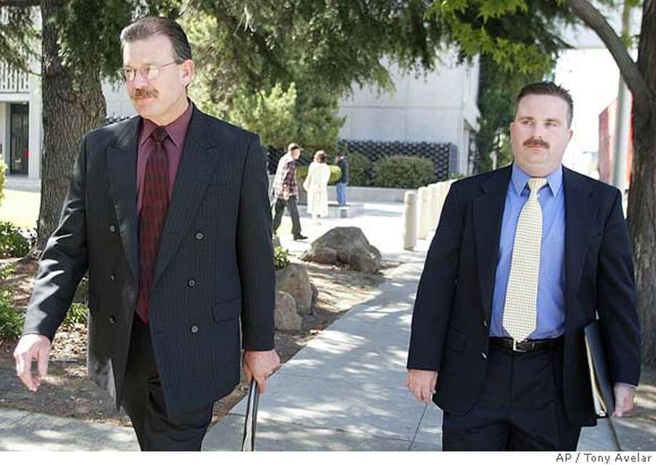Modesto Police Detectives James Richard Eichbaum, left, and Mike Hermosa leave the San Mateo County Court house after testifying on the stand in the Scott Peterson trial in Redwood City, Calif., Wednesday, July 21, 2004. Scott Peterson is the Modesto, Calif., man who is charged with the deaths of his wife Laci and their unborn son and could face the death penalty if convicted. (AP/ Palo Alto Daily News, Tony Avelar, pool) PHOTO POOL Photo: TONY AVELAR
