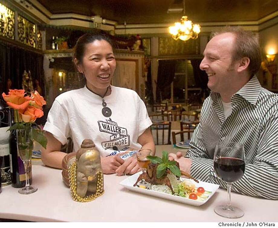 """COOKSNIGHTOUT09_024_OHARA.CR2  Thep Phanom Thai Resturant. 400 Waller st. San Francisco,CA.  Chief Robert Price of the Buckeye in Mill Valley. This is his favorite resturant,  """"Tan"""" Tanphanich Mgr. (white shirt), Patima Pak (shorter of two ladies in dress) , Wanvisa Wattandumrong ( taller lady) Photo: John O'Hara"""