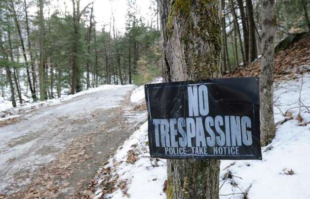 "A ""No Tresspassing,"" sign at the beginning of the isolated section of Broad Brook Road in Ashuelot, N.H., where murder victim Mary Harrison, a Greenwich native, lived, Wednesday, Jan. 25, 2012. Photo: Bob Luckey / Greenwich Time"