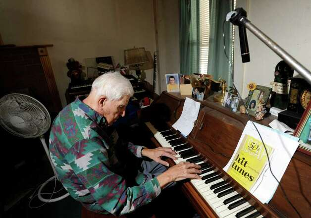 Eugene Clark, 96, plays the piano in his Ashuelot home, New Hampshire, Wednesday, Jan. 25, 2012. Clark talked to murder victim Mary Harrison shortly before she disappeared in 1981. Harrison, a Greenwich native, lived on Broad Brook Road, an isolated section of the same road that Clark lives on. Photo: Bob Luckey / Greenwich Time