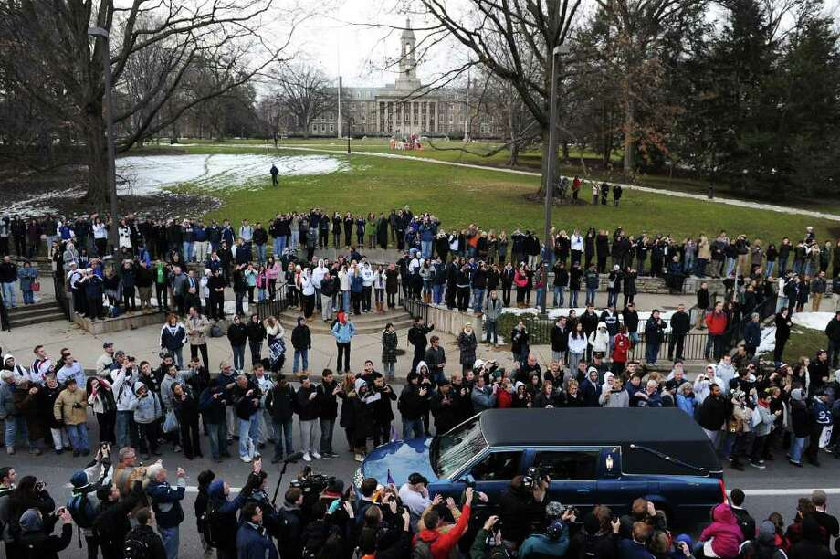 The sidewalks of College Avenue are lined Wednesday for the funeral procession of Joe Paterno. Photo: Patrick Smith / 2012 Getty Images