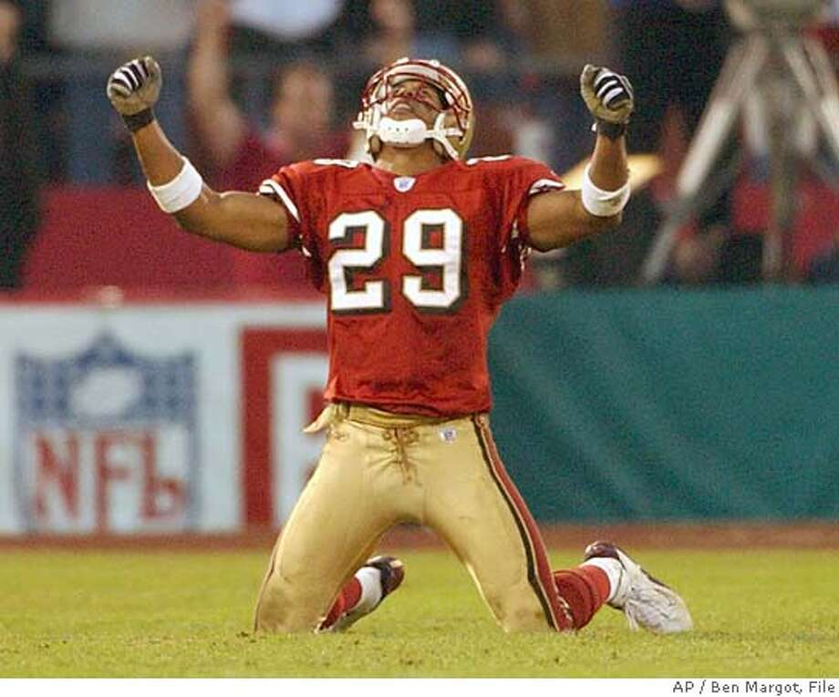 San Francisco 49ers' Ahmed Plummer reacts after the New York Giants missed a last minute field goal during the San Francisco 49ers vs' New York Giants NFC Wild Card playoff game in San Francisco, Sunday, January 5, 2003. The 49ers beat the Giants, 39-38. (AP Photo/Ben Margot) ProductNameChronicle ProductNameChronicle ProductNameChronicle CAT Photo: BEN MARGOT