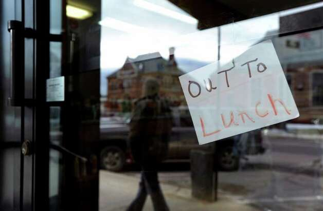 """Out to lunch,"" reads the sign on the barbershop door in downtown Winchester, N.H., Wednesday, Jan. 25, 2012. The Town of Winchester encompasses Ashuelot, where murder victim Mary Harrison, a Greenwich native, lived. Photo: Bob Luckey / Greenwich Time"