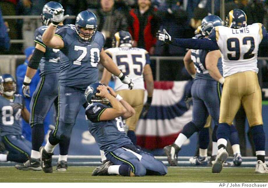 Seattle Seahawks quarterback Matt Hasselbeck, center, reacts after throwing an incomplete pass on fourth down in the closing seconds of the fourth quarter in a 27-20 loss to the St. Louis Rams in their NFC wild-card playoff game in Seattle, Saturday, Jan. 8, 2005. (AP Photo/John Froschauer) Photo: JOHN FROSCHAUER