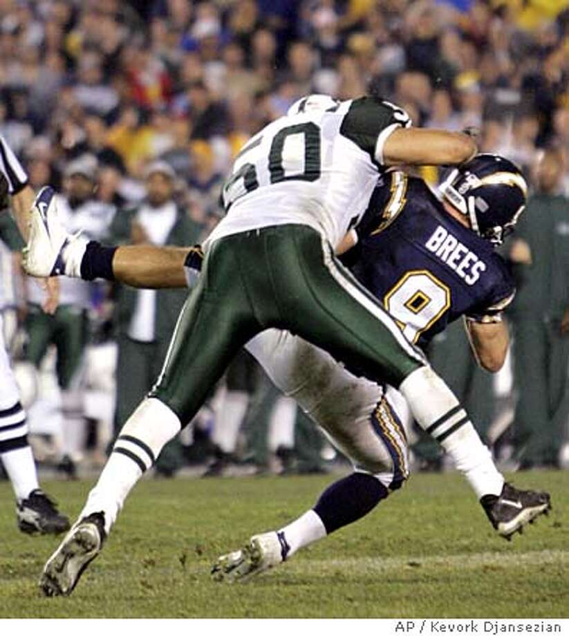 San Diego Chargers quarterback Drew Brees (9) is taken down by New York Jets linebacker Eric Barton (50) after releasing a pass late in the fourth quarter of the AFC wild-card game in San Diego, Saturday, Jan. 8, 2005. The Jets got a penalty for roughing the passer setting the Chargers up for a touchdown. The Jets won 20-17 in overtime. (AP Photo/Kevork Djansezian) Photo: KEVORK DJANSEZIAN