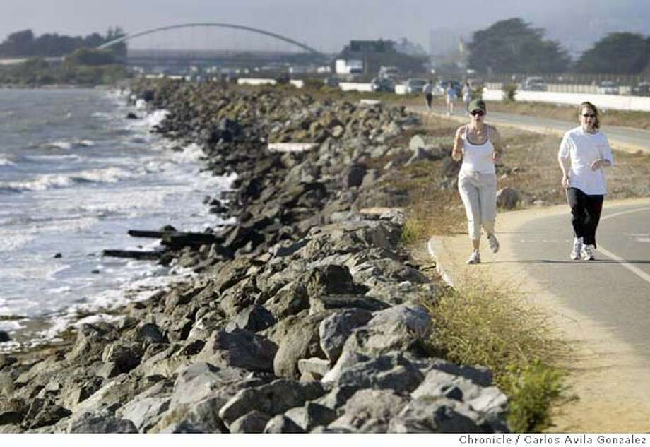 Laurel Ordu�a, left, of Berkeley, and Heather Mamounas, of Clayton, train for a half marathon on the new paved path on the East Shore State Park off Berkeley, Ca., on Wednesday, July 21, 2004. Photo taken on 07/21/04 in Berkeley, Ca. Photo By Carlos Avila Gonzalez / The San Francisco Chronicle Photo: Carlos Avila Gonzalez