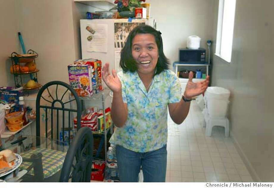 Lydia Ghazzawi is still overcome with happiness in her Pacifica apartment as she makes breakfast for relatives and friends.  Angelo de la Cruz, a Filipino truck driver held hostage in Iraq for nearly two weeks was freed Tuesday, a day after his nation withdrew its final peacekeepers from Iraq. His sister, Pacifica resident Lydia Ghazzawi never gave up hope and is now planning a reunion in the Phillippines with her brother.  Photo by Michael Maloney / San Francisco Chronicle Photo: Michael Maloney