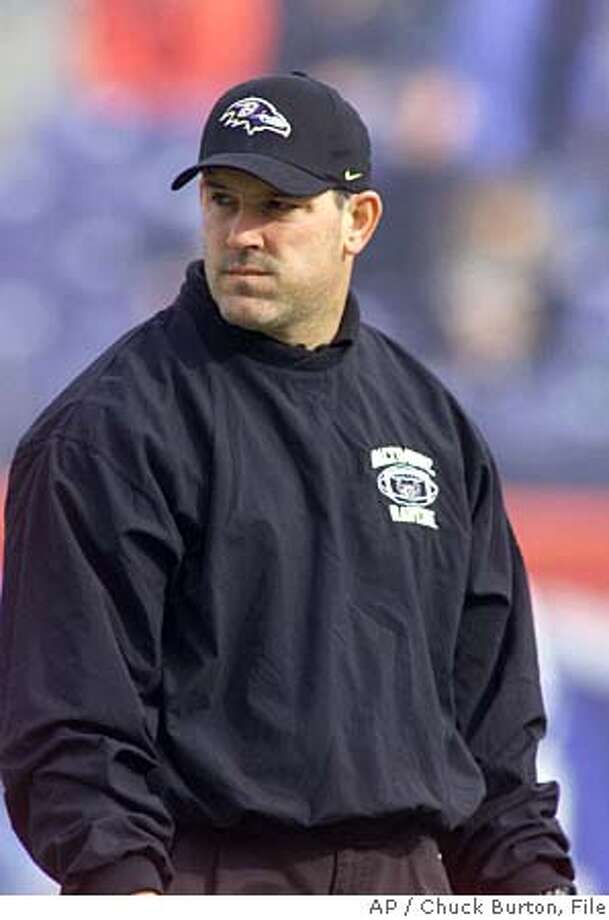 Baltimore Ravens offensive coordinator Matt Cavanaugh looks on as the teams warm up before a playoff game against the Tennessee Titans in Nashville Sunday January 7, 2001. The Ravens will meet the New York Giants in Super Bowl XXXV Sunday Jan. 28 in Tampa, Fla. (AP Photo/Chuck Burton) DIGITAL IMAGE Photo: CHUCK BURTON