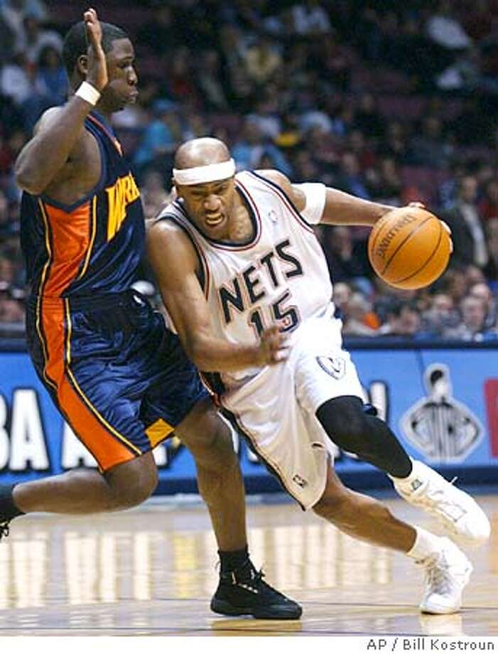 New Jersey Nets' Vince Carter, right, attempts to drive around Golden State Warriors' Mickael Pietrus, of France, during the second quarter Friday night, Jan 7, 2005, in East Rutherford, N.J. (AP Photo/Bill Kostroun) Photo: BILL KOSTROUN