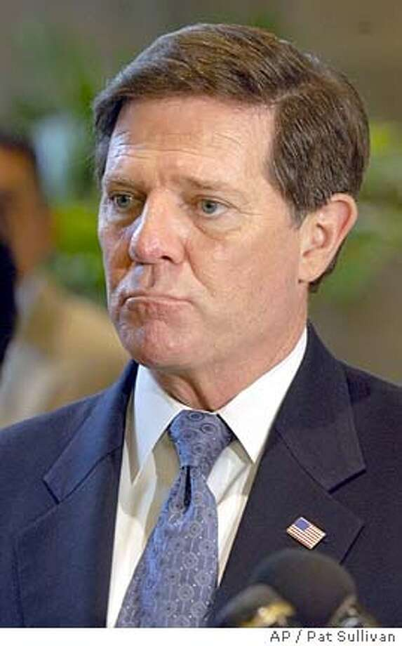 **FILE**House Majority Leader Tom DeLay ponders a question during a press conference in Houston in this Oct. 22, 2004 file photo. House Republicans suddenly reversed course Monday, Jan. 3, 2005 deciding to retain a tough standard for lawmaker discipline and reinstating a rule that would force Majority Leader Tom DeLay to step aside if indicted by a Texas grand jury. (AP Photo/Pat Sullivan) FILE Photo: PAT SULLIVAN