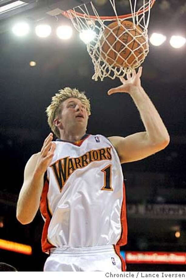 WARRIORS_150.jpg_ Golden State Warriors' Troy Murphy follows a warriors score in first half action. The Warriors lead at the half 56-41 Wed, Nov. 17, 2004, in Oakland. By Lance Iversen/San Francisco Chronicle Ran on: 11-18-2004  Jason Richardson scores with Dale Davis awaiting a possible rebound for the Warriors. MANDATORY CREDIT PHOTOG AND SAN FRANCISCO CHRONICLE. Photo: Lance Iversen