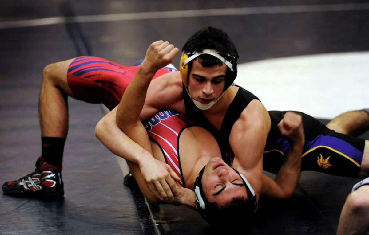 Westhill's Nick Jimenez and Brien McMahon's Jamie Restivo compete in the 152 lb. weight class Wednesday, Jan. 25, 2012 during a wrestling meet at Brien McMahon High School in Norwalk, Conn.