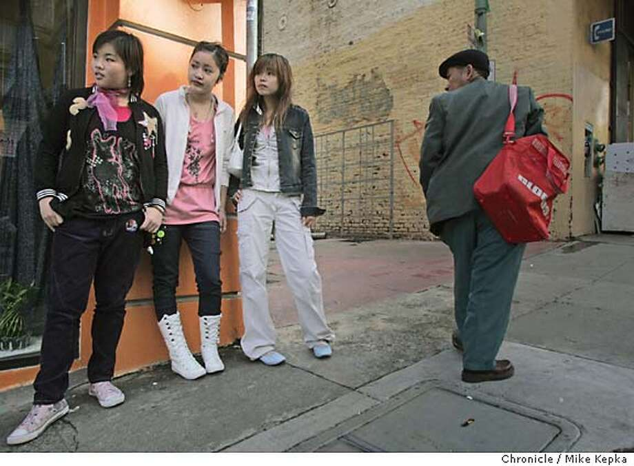 """onlcationStockton188_mk.jpg  2:04 p.m. After leaving a trending boutique in San Francisco' s China Town, Polly Wang, Fang Zhen, and Helen Xue look for their next shopping destination with """"Japanese Style and Hong Kong Style"""" in mind.  ON Location Stockton and Clay 12/29/04  Mike Kepka/The Chronicle MANADATORY CREDIT FOR PHOTOG AND SF CHRONICLE/ -MAGS OUT Photo: Mike Kepka"""