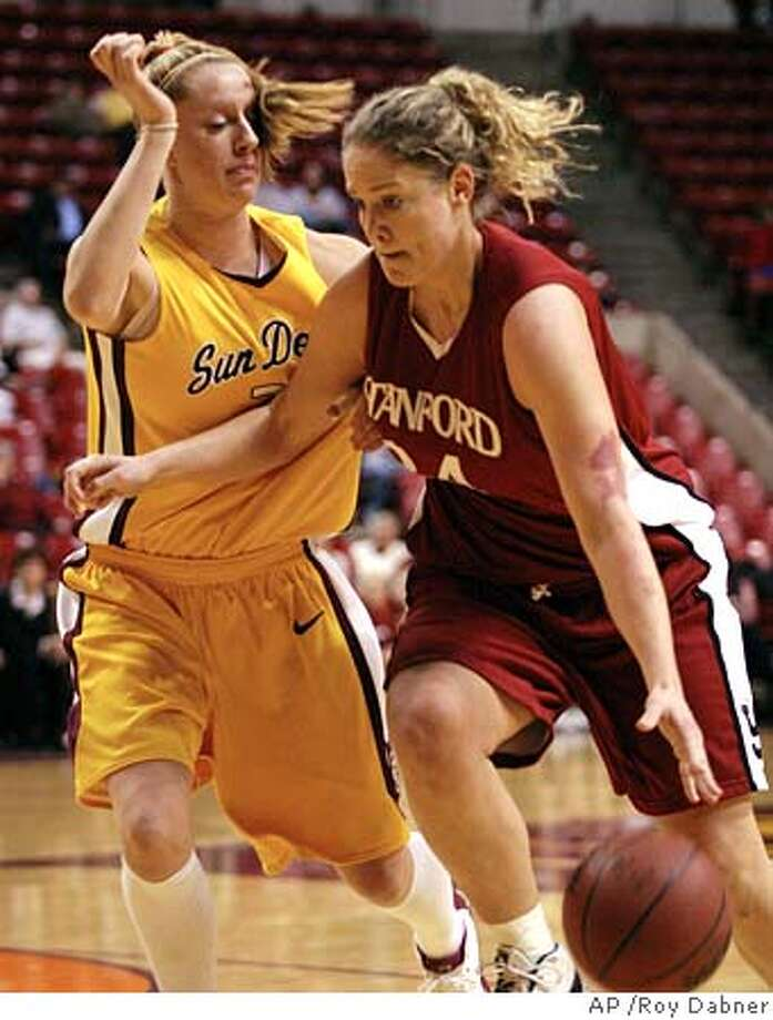 Stanford forward T'Nae Thiel drives the lane on Arizona State's Aubree Johnson in the first half Friday, Jan. 7, 2005, in Tempe, Ariz. (AP Photo/Roy Dabner) Photo: ROY DABNER