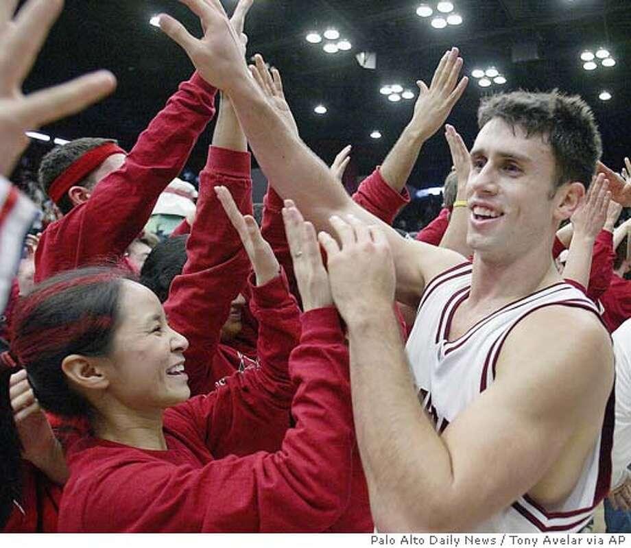 Stanford's Chris Hernandez, right, celebrates with Stanford students after beating No. 13 Arizona 87-76, Saturday Jan. 8, 2005 at Stanford, Calif. (AP Photo/Palo Alto Daily News, tony Avelar) Photo: TONY AVELAR
