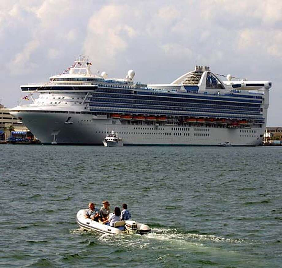 FILE--The Grand Princess, docked in Fort Lauderdale, Fla., prepares for a seven-day cruise through the Caribbean March 4, 2001. P&O Princess Cruises PLC is merging with Miami-based Royal Caribbean Ltd. in a deal worth about $3 billion that creates the world's largest cruise ship company. (AP Photo/Luis M. Alvarez) Photo: LUIS M. ALVAREZ
