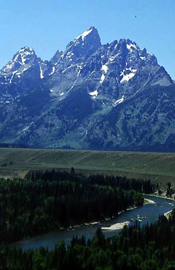 TRAVEL WYOMING -- A visit to Wyoming�s national parks must include pulling include a pull over for picture taking of the Teton Mountains and Snake River below. Credit: Egret Communications OK to use on SFGate