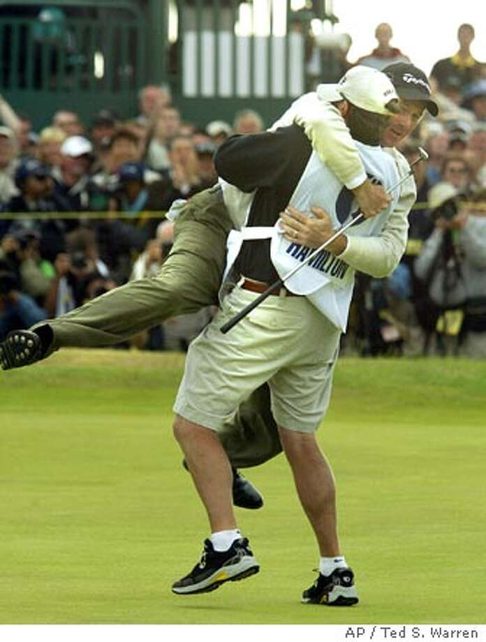 Todd Hamilton of the United States jumps into the arms of his caddie Ron Levin after winning the golf championship at Royal Troon golf course in Troon, Scotland Sunday July 18, 2004. Hamilton won the Open championship after beating South Africa's Ernie Els in a play-off. (AP Photo/Ted S. Warren) ** EDITORIAL USE ONLY ** Photo: TED S. WARREN