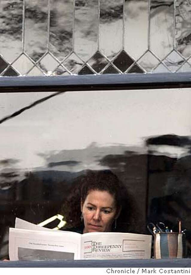 THREEPENNY07_113_mc.jpg  About 25 years ago � or 100 issues ago � a precocious, 27-year-old Wendy Lesser(pictured here throught her window reading the 100th issue) started a belle lettres sort of literary magazine in her home in Berkeley. Now, as the Threepenny Reviews celebrates its 100th issue, it�s one the most prestigious publications of its sort in the country, publishing a stunning calibre of writers and poets working all sorts of genres. We talk to Lesser about the publication and give readers a sense of the importance of this quarterly published on a shoe-string budget in Berkeley. Mark Costantini / The Chronicle MANDATORY CREDIT FOR PHOTOG AND SF CHRONICLE/ -MAGS OUT Photo: Mark Costantini