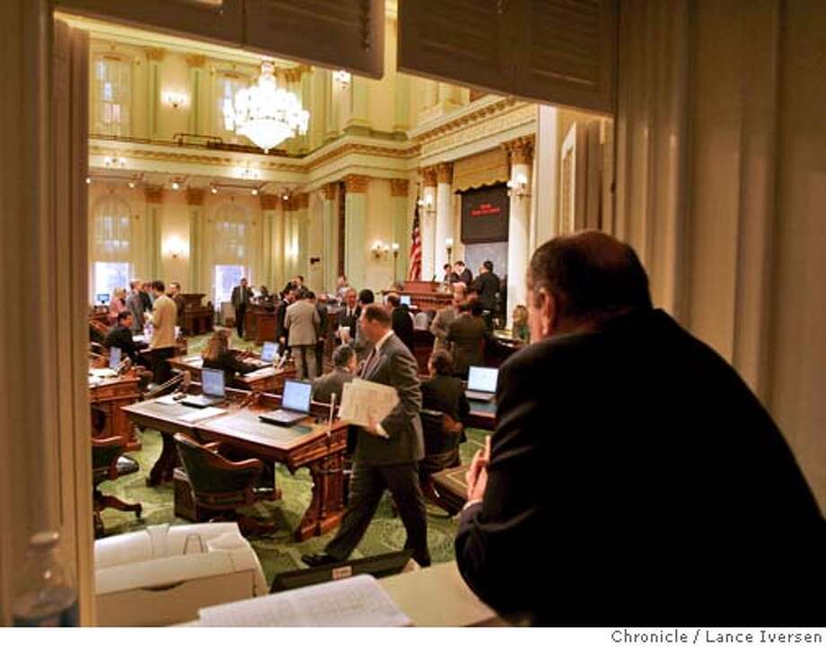MIDDLE_042.jpg_  A spectator views the Ca State Assembly floor from the media booth. After last night's State of the State address by Gov. Arnold Schwarzenegger, both the Assembly and Senate held special sessions to start the process of balancing the budget Thursday. By Lance Iversen/San Francisco Chronicle MANDATORY CREDIT PHOTOG AND SAN FRANCISCO CHRONICLE. Photo: Lance Iversen