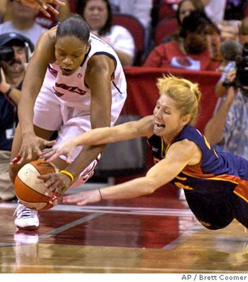 Houston Comets' Tina Thompson, left, and Connecticut Sun's Debbie Black dive for a loose ball during the first half Saturday, July 17, 2004, in Houston. (AP Photo/Brett Coomer) Photo: BRETT COOMER
