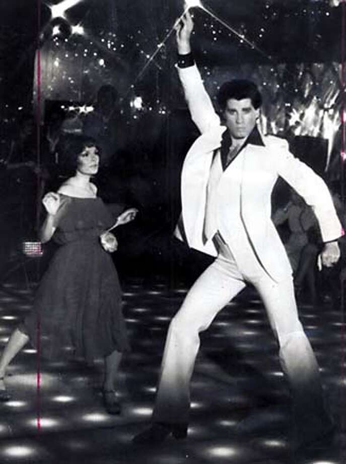 """LASALLE02  KAREN GORNEY AND JOHN TRAVOLTA IN """"SATURDAY NIGHT FEVER"""" D.W. Griffith took the epic to new heights with &quo;In- tolerance&quo; in 1916."""