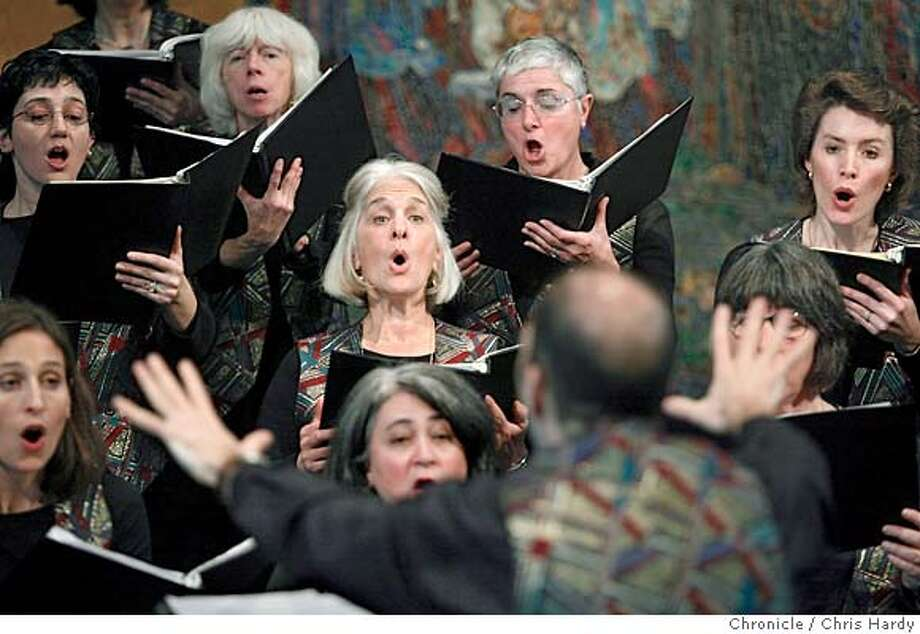 121204_eblchoruses_ch067.jpg  Adina Sara, in the center with gray hair, following directoins.  VOCI, a 22-member all women's chorus that does classical, folk and gives proceeds to Global Fund for Women. They are in rehearsing at the United Methodist church in Oakland,CA on 12/12/04  San Francisco Chronicle/Chris Hardy MANDATORY CREDIT FOR PHOTOG AND SF CHRONICLE/ -MAGS OUT Photo: Chris Hardy