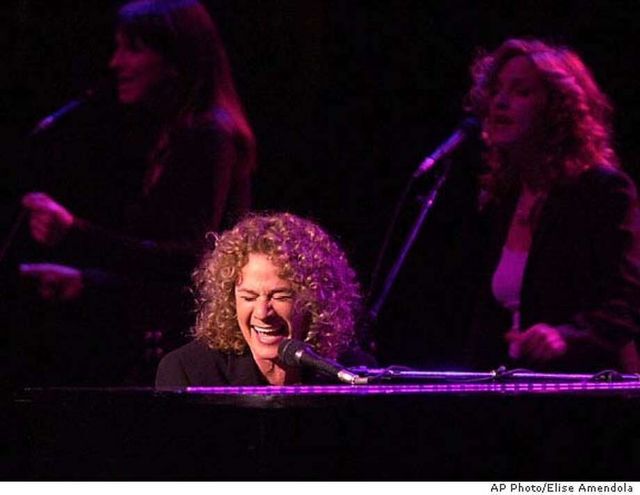 Carole King performs at a concert fundraiser for the 2002 re-election campaign for Sen. John Kerry, D-Mass., at the Wang Center in Boston, Monday, Dec. 3, 2001. (AP Photo/Elise Amendola) CAT DIGITAL IMAGE Photo: ELISE AMENDOLA