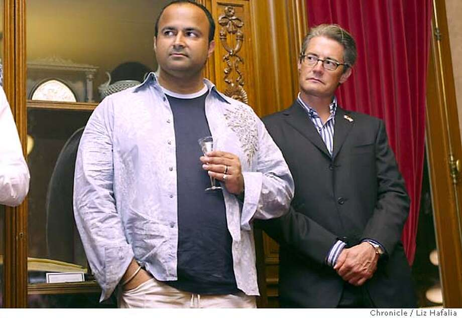"""At left is director and writer Ian Iqbal Rashid with actor Kyle MacLachlan in """"Touch of Pink"""" in the Mayor's office. Opening night of Frameline28--the San Francisco International Lesbian and gay Film Festival--at the Castro with a party afterward at City Hall rotunda.  San Francisco on 6/17/04 by LIZ HAFALIA / The Chronicle Photo: LIZ HAFALIA"""