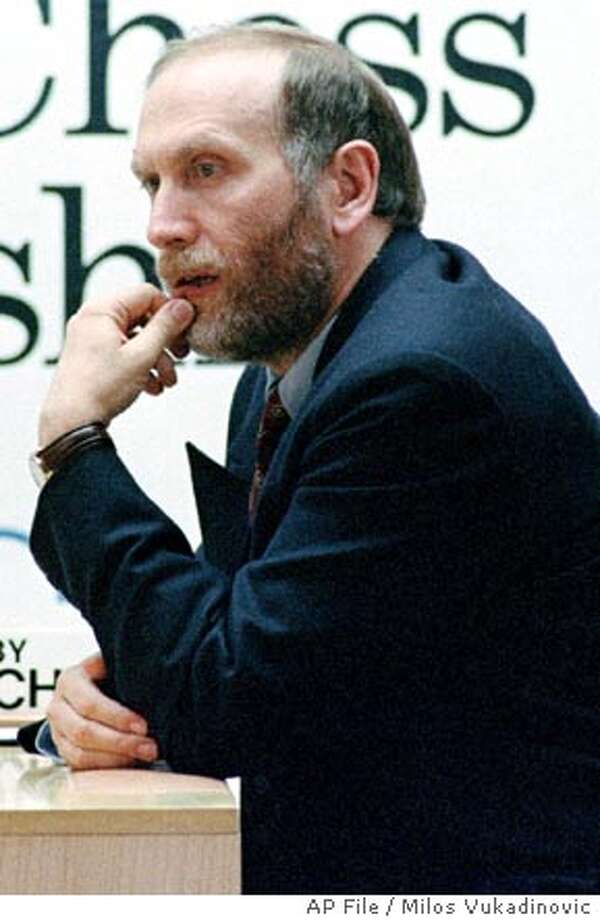 **FILE** American Bobby Fischer pauses before the start of the fifth game in Sveti Stefan, Yugoslavia, in this Sept. 9, 1992 file photo. Bobby Fischer, the chess world's most eccentric star, was taken into custody after trying to fly out of Japan with an invalid passport, Friday, July 16, 2004. Fischer is wanted by US authorities for attending a 1992 match in Yugoslavia despite international sanctions, the American former world champion had managed to stay one move ahead of the law by living abroad and being sheltered by chess devotees. (AP Photo/ str/ Milos Vukadinovic, File) Photo: MILOS VUKADINOVIC