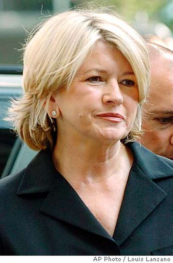 "arrives for sentencing at Manhattan federal court, in New York Friday July 16, 2004. Stewart, dressed simply in a black pantsuit, showed no emotion as she strode briskly through a media horde. Supporters applauded and one shouted, ""Hold your head high, Martha!"" (AP Photo/Louis Lanzano) Photo: LOUIS LANZANO"