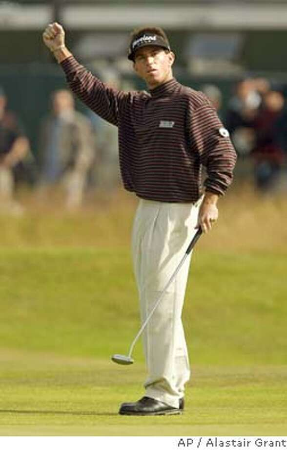 Skip Kendall of the United States celebrates after making an eagle on the 16th on the second day of the British Open golf championship at Royal Troon golf course in Troon, Scotland Friday July 16, 2004. Kendall scored a 66 to go 7-under par for the tournament. (AP Photo/Alastair Grant) ** EDITORIAL USE ONLY ** EDITORIAL USE ONLY Photo: ALASTAIR GRANT