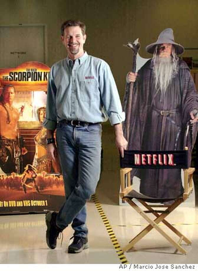 ** ADVANCE FOR MONDAY OCT. 25 ** FILE ** Reed Hastings, founder and CEO of Netflix, poses in one of the company's distribution centers in San Jose, Calif., Jan. 29, 2004. Convinced that Amazon.com Inc. is about to enter the booming DVD rental market, Netflix is scrambling for survival as it girds for a brutal price war likely to determine whether the company becomes a home entertainment powerhouse or disintegrates into another dot-com pipe dream. (AP Photo/Marcio Jose Sanchez) Ran on: 10-25-2004  Netflix CEO Reed Hastings is readying his company for what could turn into a brutal price war in the DVD rental business. Ran on: 01-05-2005  Reed Hastings has angered both liberals and conservatives in the state Senate. Photo: MARCIO JOSE SANCHEZ