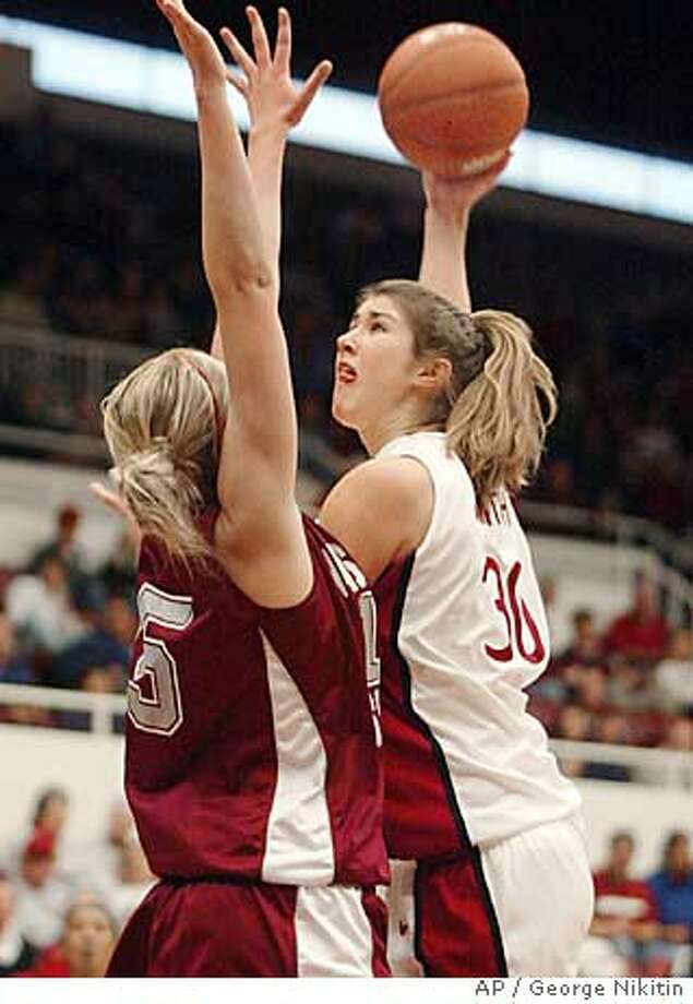 Stanford's Brooke Smith makes a hook shot over Washington State's Emma Joneby, Sunday Jan. 2, 2005 in Stanford, Calif. (AP Photo/George Nikitin) Photo: GEORGE NIKITIN