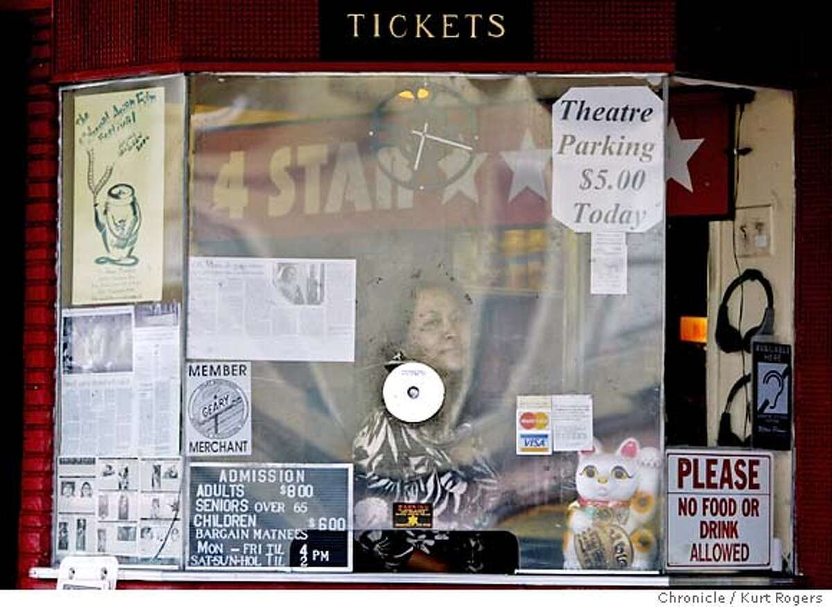 Lida Lee behind the ticket booth. 4-Star Theater, there since 1919, is on track to close in May 2005 when lease runs out. It is the only theater in the city that shows first-run movies from Hong-Kong. Owner is fighting to stay open. 7/9/04 in San Francisco,CA. Kurt Rogers/The Chronicle