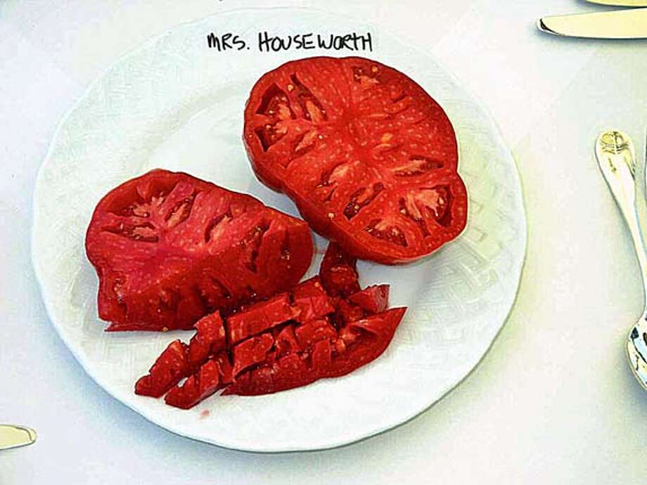 "sliced Mrs. Houseworth heirloom tomato showing ""meaty"" consistency"