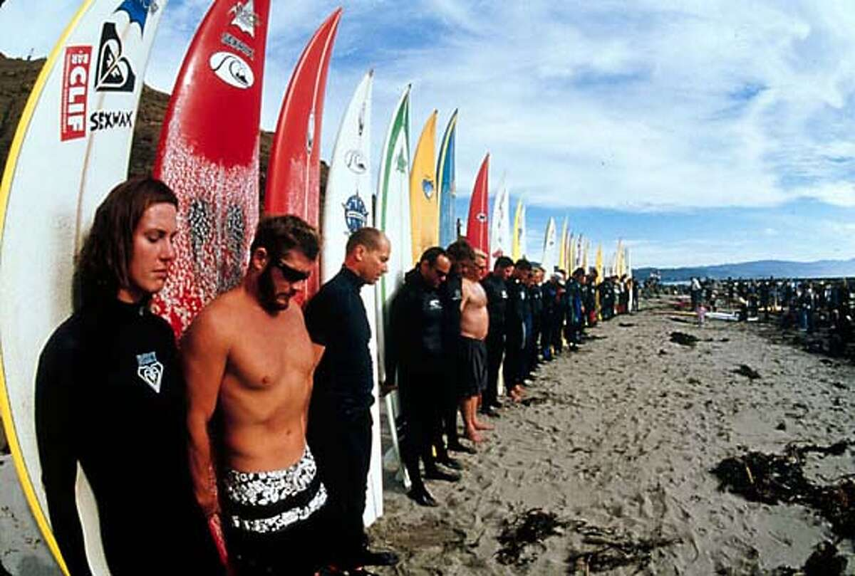 Surfers memorialize Mark Foo at Mavericks, where the surfer died in 1994, in the documentary