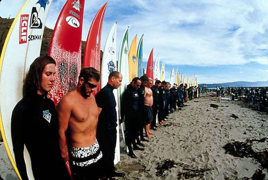 """Surfers memorialize Mark Foo at Mavericks, where the surfer died in 1994, in the documentary """"Riding Giants"""" (PG-13), which opened this weekend at Bay Area theaters."""