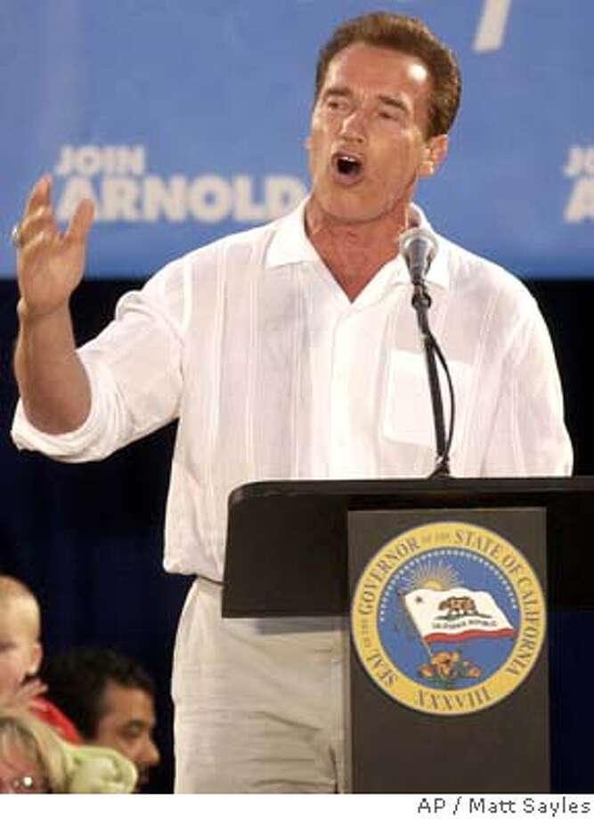 "California Gov. Arnold Schwarzenegger speaks at a ""Citizens Rally"" at the Ontario Mills Shopping Center in Ontario, Calif., Saturday, July 17, 2004. With partisan disputes having stalled negotiations over the already late , Schwarzenegger again went directly to voters, reusing a tactic that has helped break previous legislative deadlocks. (AP Photo/Matt Sayles) Photo: MATT SAYLES"