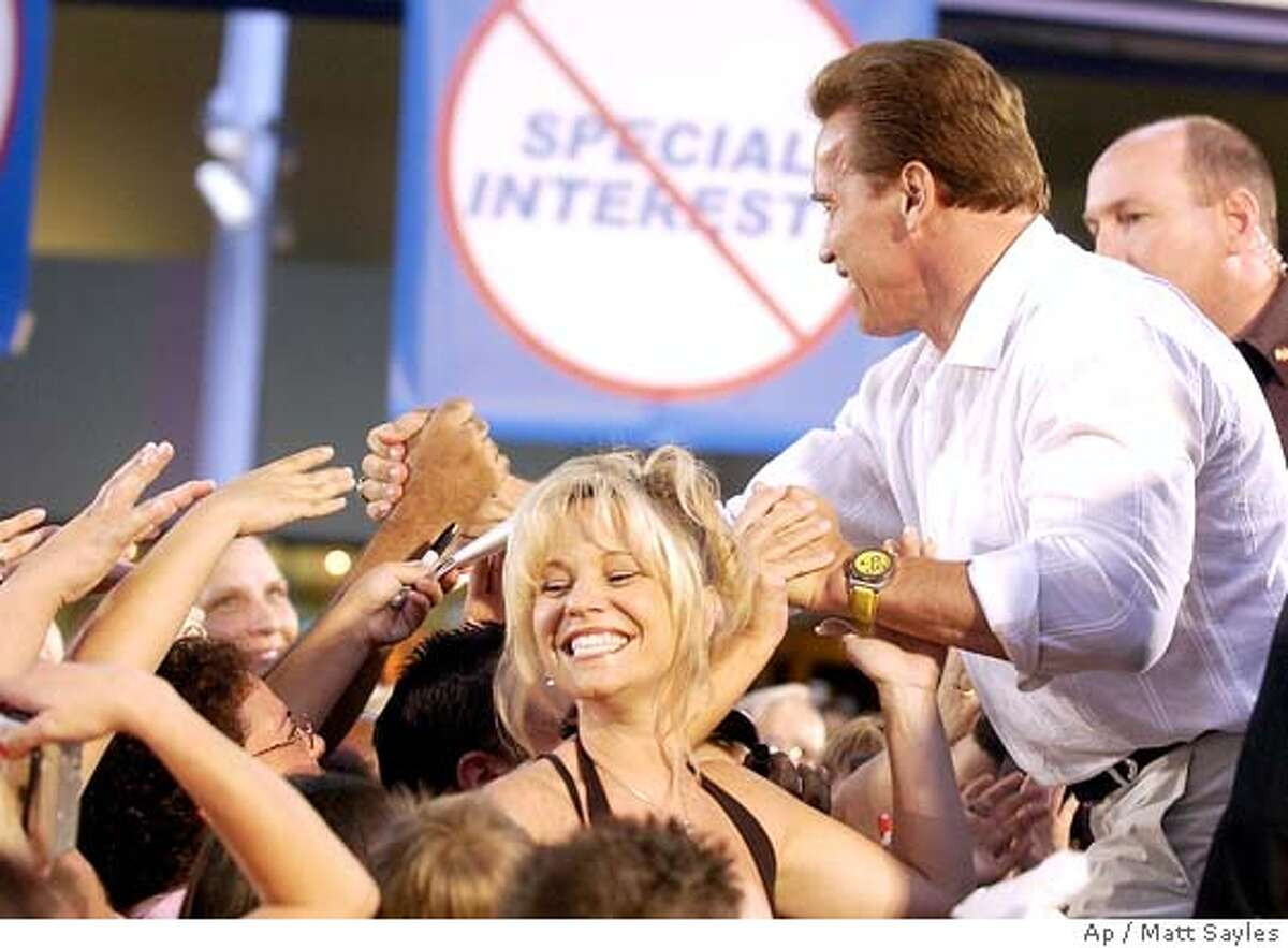California Gov. Arnold Schwarzenegger shakes hands with fans after addressing a rally at the Ontario Mills Shopping Center in Ontario, Calif., Saturday, July 17, 2004, to gather support for the . (AP Photo/Matt Sayles)