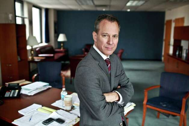 "FILE -- New York State Attorney General Eric Schneiderman, the co-chair of a new federal task force to investigate the housing crisis, in his office in New York, Sept. 20, 2011. Schneiderman promised on Wednesday to pursue ""every aspect of the conduct that created the bubble and crash,"" and to take a different approach from previous efforts to prosecute wrong-doing. (Fred R. Conrad/The New York Times) Photo: FRED R CONRAD / NYTNS"