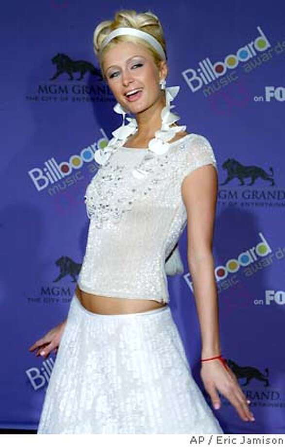 Paris Hilton poses on the red carpet during The Wednesday, Dec. 10, 2003 at the MGM Grand Hotel and Casino in Las Vegas.(AP Photo/Eric Jamison) Photo: ERIC JAMISON