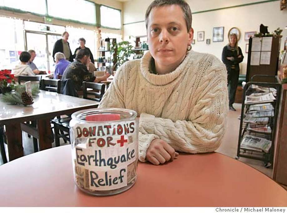 GIVING04_002_MJM.jpg  Tim Holmes, owner of Zocalo Coffeehouse n San Leandro with his Quake relief jar.  Tim Holmes was out of town when the tsunami crushed southern Asia, so he called into his Zocalo Coffeehouse in San Leandro to suggest that his staff put out a jar for relief donations. His staff already had one out for two days. In addition, Holmes donated all the revenues from Jan. 1 to relief victims. While corporations are giving millions, and the U.S. government is somewhat belatedly chipping in, many individuals like Holmes are giving, too. Photo by Michael Maloney / San Francisco Chronicle MANDATORY CREDIT FOR PHOTOG AND SF CHRONICLE/ -MAGS OUT Photo: Michael Maloney
