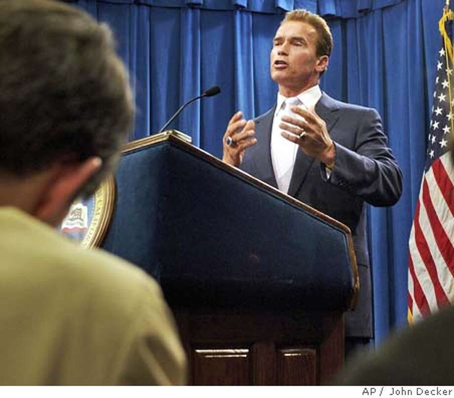 California Gov. Arnold Schwarzenegger talks to reporters about the stalled budget process from a conference room at the State Capitol on Thursday, July 15, 2004, in Sacramento, Calif. (AP Photo/Sacramento Bee, John Decker) Photo: JOHN DECKER