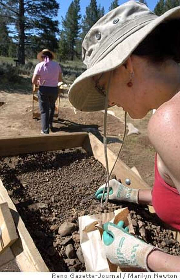 Shannon Novak a forensic archaeologist from Idaho State retrieves a piece of bone at the Alder Creek archaeological site where it is believed the Donner Party camped. Tuesday July 13, 2004. In front of her is Leslie Fryman, a historical archaeologist from Sacramento Calif. photo by marilyn newton - reno gazette-journal Photo: Marilyn Newton