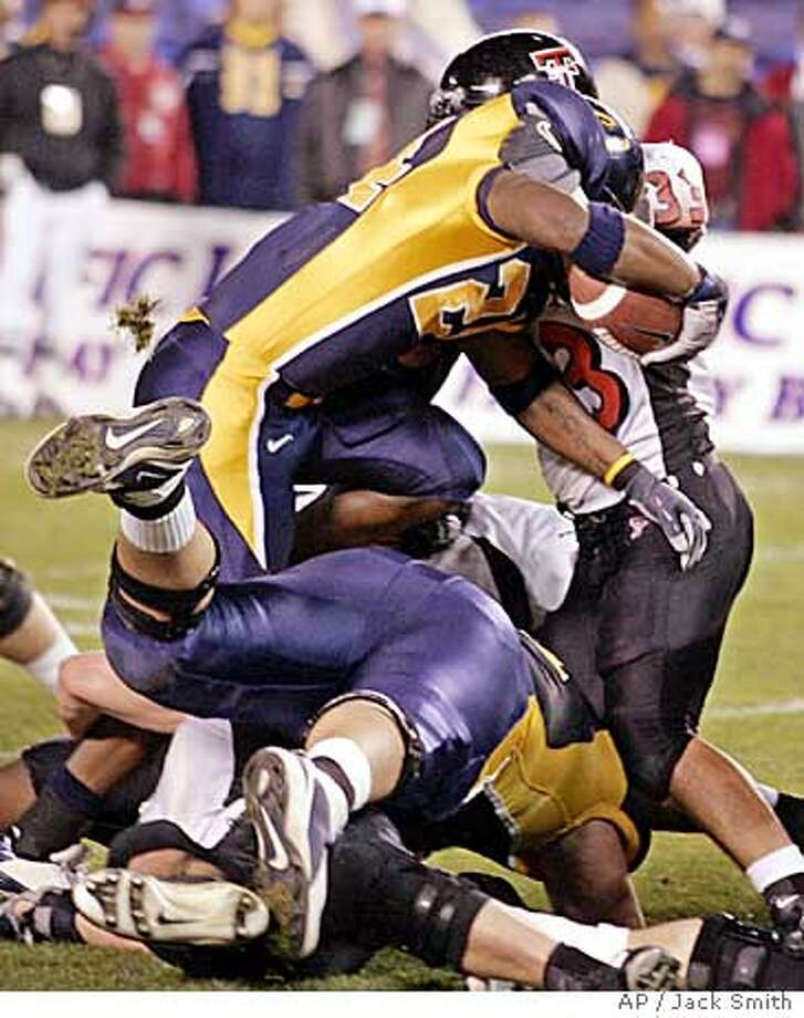California runningback Marshawn Lynch plows through the Texas Tech defense for a five yard touchdown run in the first quarter of the Holiday Bowl Thursday Dec. 30, 2004 in San Diego. (AP Photo/Jack Smith) Ran on: 01-04-2005  Freshman Marshawn Lynch gave the Bears a nice one-two punch at running back along with J.J. Arrington in 2004. Ran on: 01-04-2005  Freshman Marshawn Lynch gave the Bears a nice one-two punch at running back along with J.J. Arrington in 2004. Photo: JACK SMITH