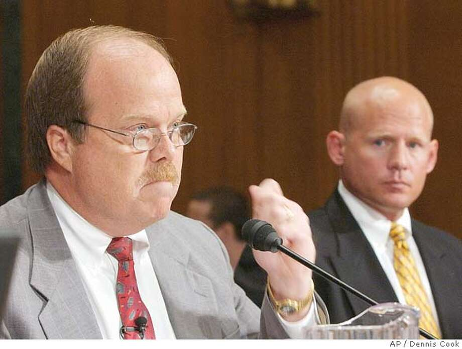 Don Hooten, whose son committed suicide after using steroid drugs, testifies on Capitol Hill Tuesday, July 13, 2004, before the Senate Caucus on International Narcotics Control. At right is convicted steroid user and dealer Curtis Wenzlaff. (AP Photo/Dennis Cook) Photo: DENNIS COOK