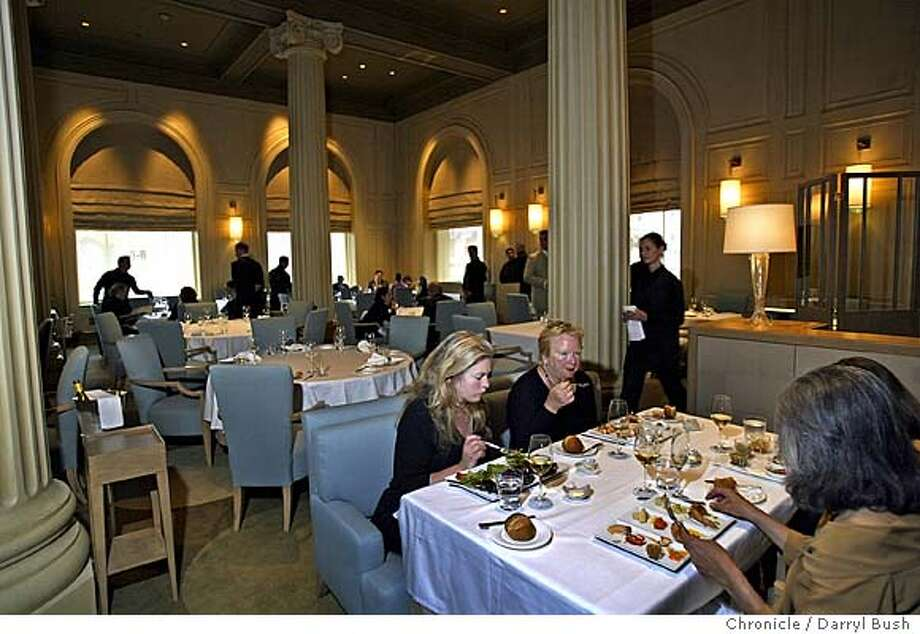 At table from left is Jane Connors of San Francisco, Priscilla Coe, back left, and Eleanor Bertino of San Francisco (back turned), front right, as they eat during a practice dinner at the new Restaurant Michael Mina inside the Westin St. Francis hotel at Union Square. 7/6/04 in San Francisco  Darryl Bush / The Chronicle Photo: Darryl Bush