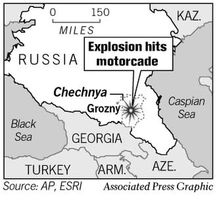 Explosion Hits Motorcade. Associated Press Graphic