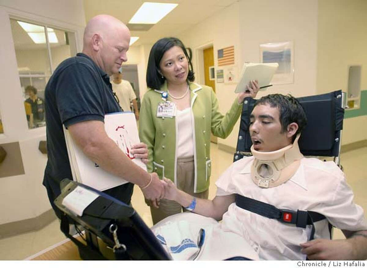 Defense & Veterans Brain Injury Center in Palo Alto where we met Alec Giess (left), a combat engineer, who was in a truck accident in Iraq last December where the truck overturned and landed on him. Nurse manager Stephanie Alvarez (middle). Giess is shaking the hand of Jerry Vang (right), 22, who has traumatic brain injury. Shot on 6/29/04 in San Francisco. LIZ HAFALIA / The Chronicle